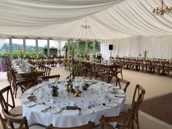 Marquee with round and long table set-up